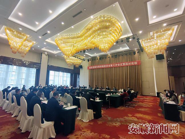 政协第四讨论组讨论政府工作报告及两院报告现场.jpg